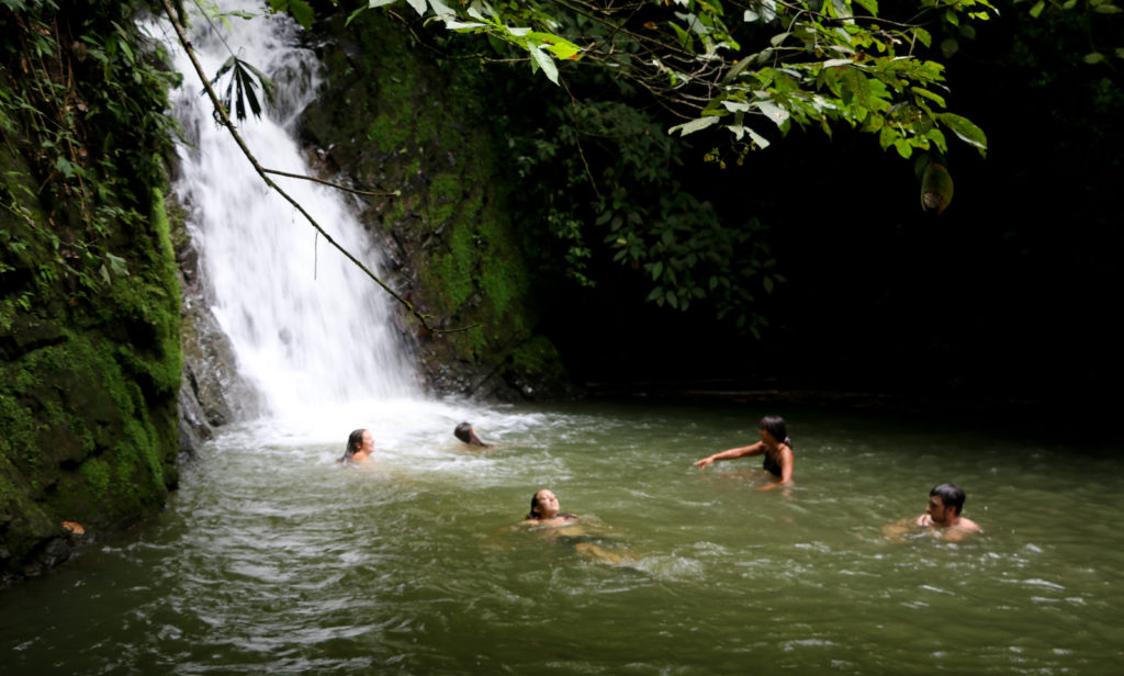 Swimming below a waterfall near the Pacuare eco camp