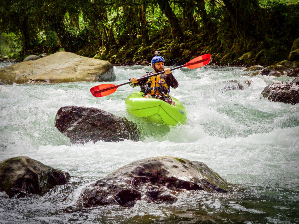 Paddling a packraft on the Rio Pacuare Headwaters