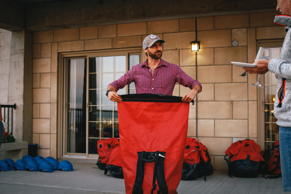 Magpie River guide Yan Goyette showing drybags
