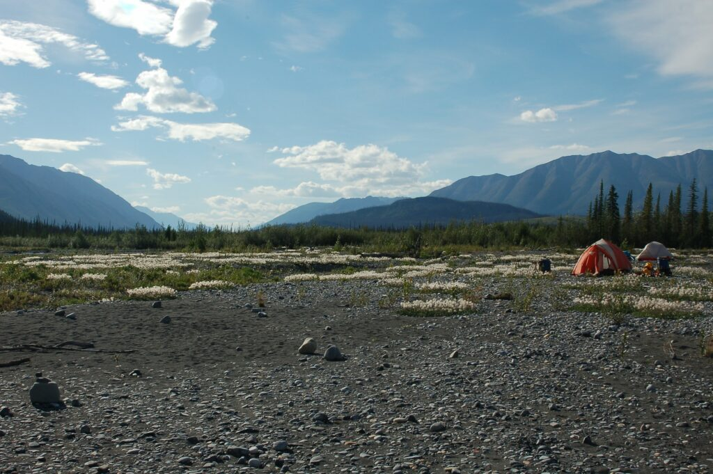 Photo of a campsite along the Nahanni River on a Black Feather trip
