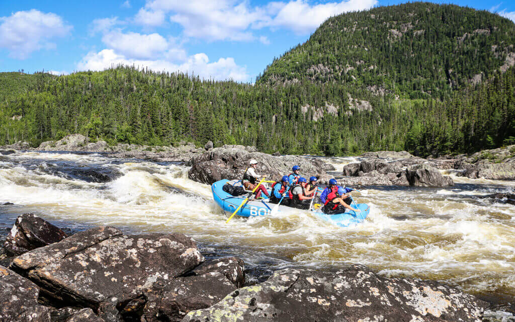 Rafting down a set of rapids on the Magpie River