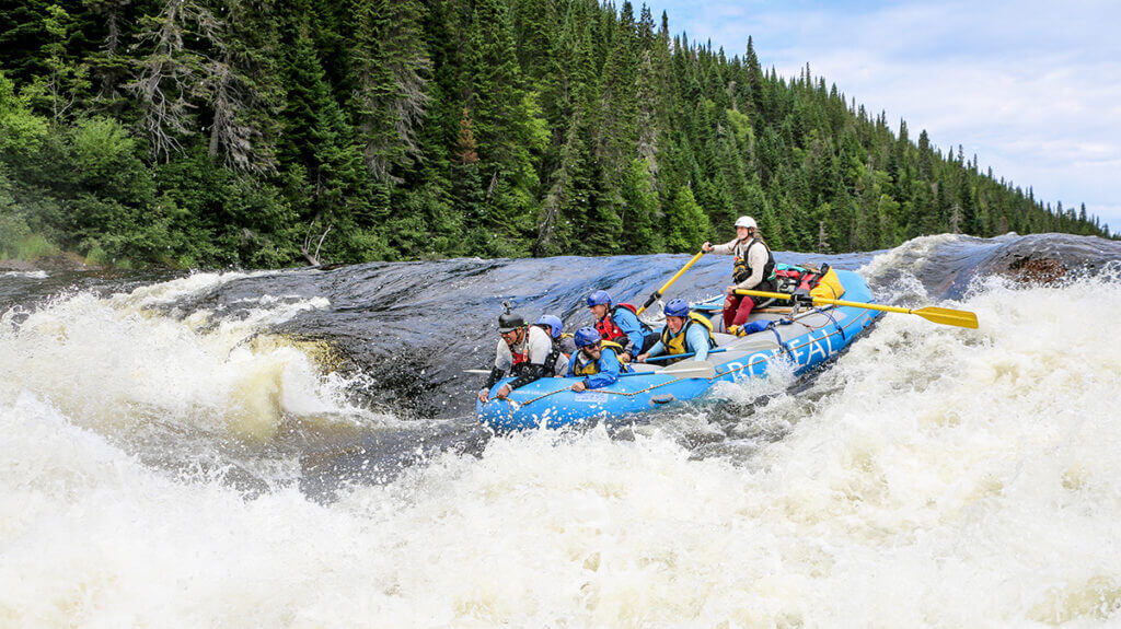 White water rafting down a big set of rapids